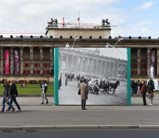 epa04708935 Pedestrians look at a wall which shows a historic photograph of the place from May 1945 in front of the Old Museum in the Lust garden in Berlin, Germany, 17 April 2015. The exhibition 'May 1945 - Spring in Berlin' illustrates the destruction and reminds of the end of World War II seventy years ago on 08 May 1945 at six different spots in the city.  EPA/JENS�KALAENE ����: EPA/JENS KALAENE