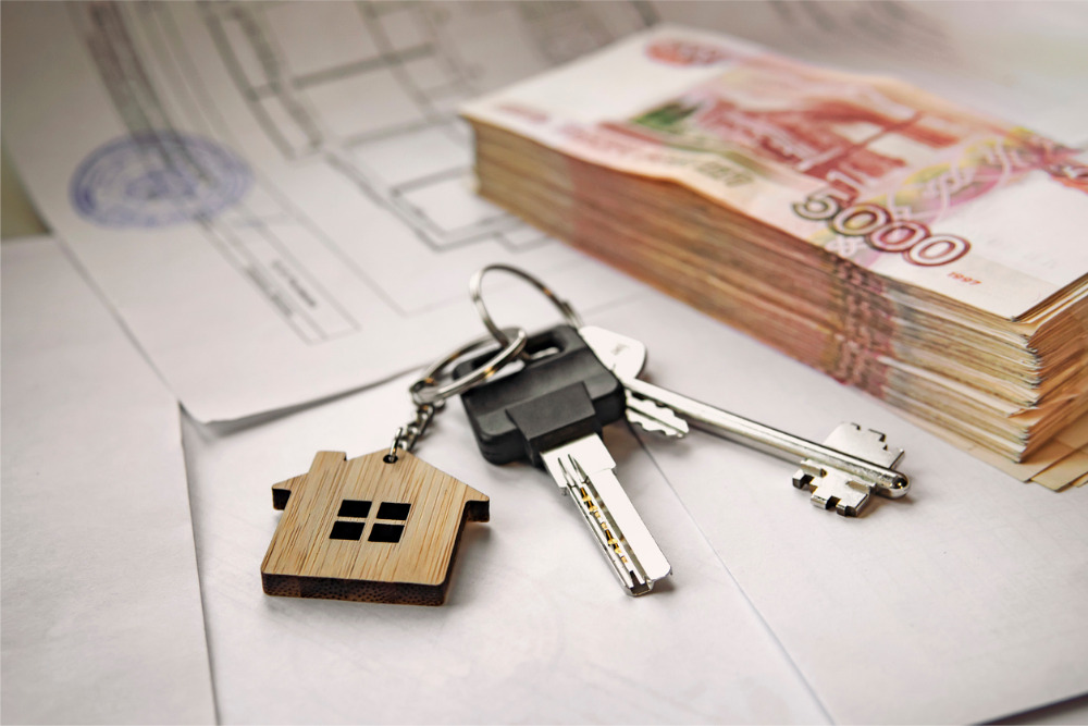banknotes of russian rubles and keys to the apartment estate sale the picture id